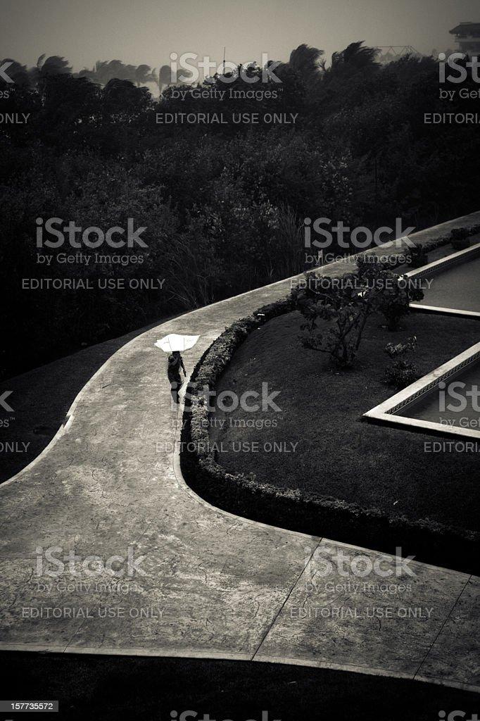 Man walking with umbrella royalty-free stock photo