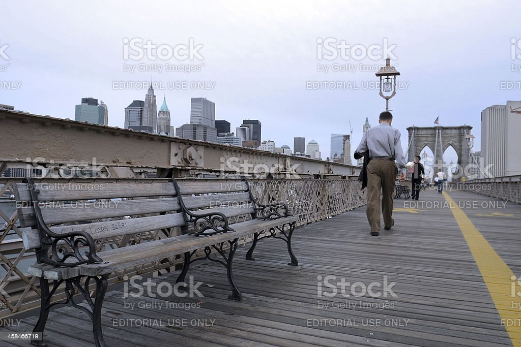 Man walks over the Brooklyn bridge royalty-free stock photo