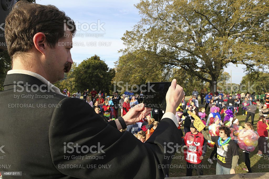 Man was filming participants using a tablet computer royalty-free stock photo