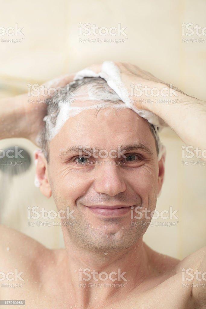 Man washing hair stock photo