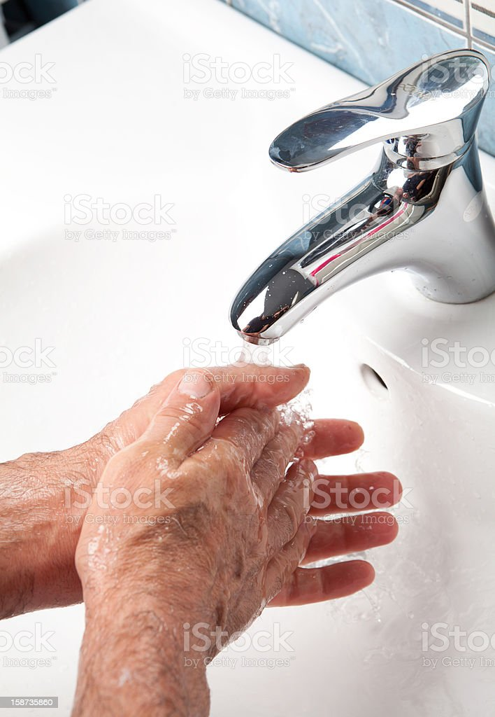 Man washing hands royalty-free stock photo