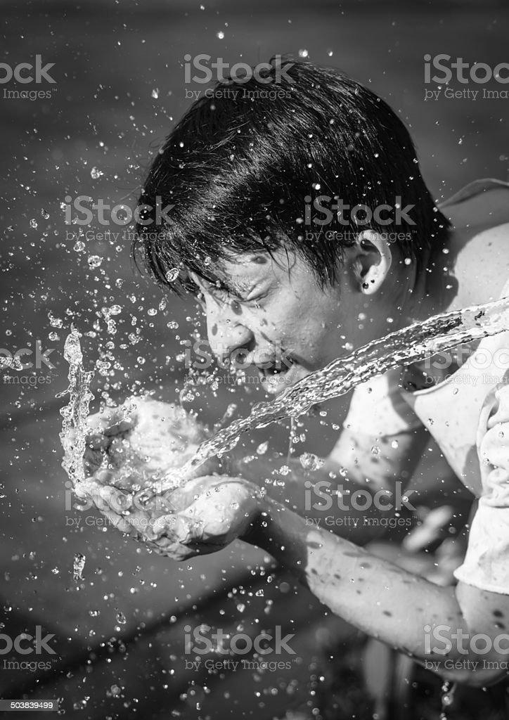 man washing him face stock photo