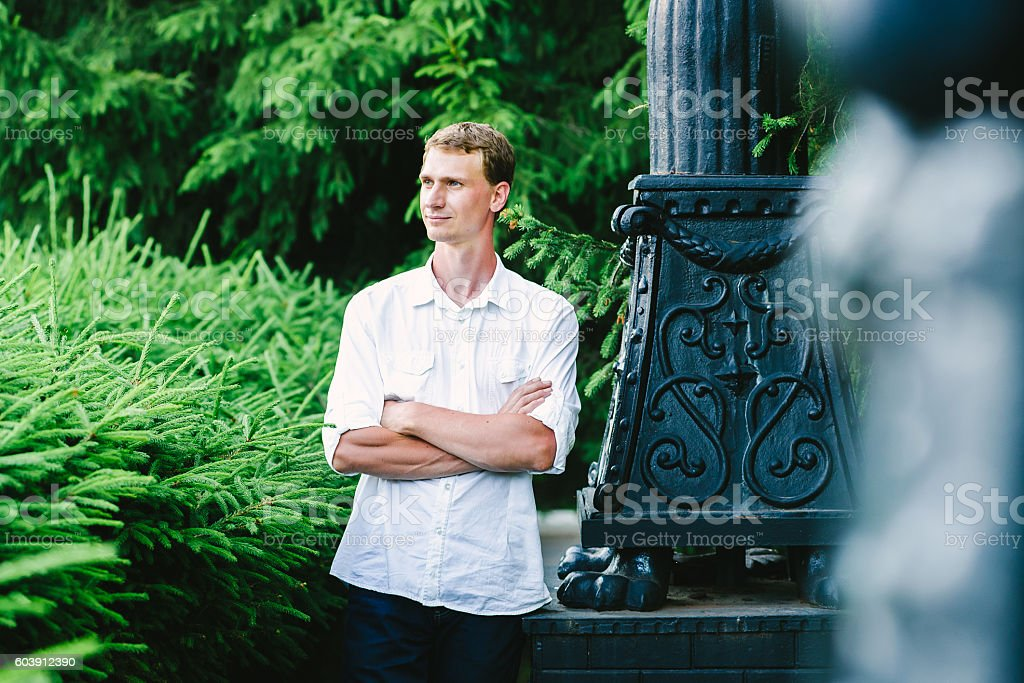 man watches aside calmly and confidently stock photo