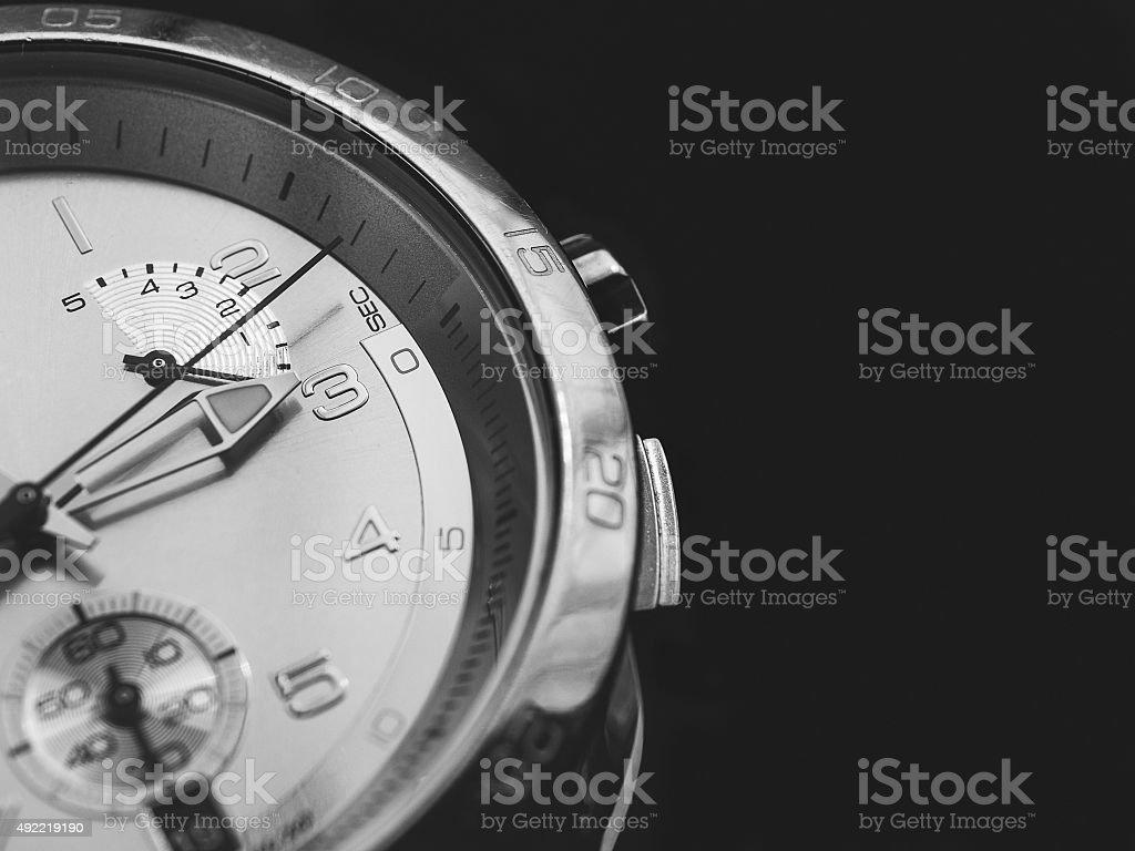 Man watches detail, closeup, dark background stock photo