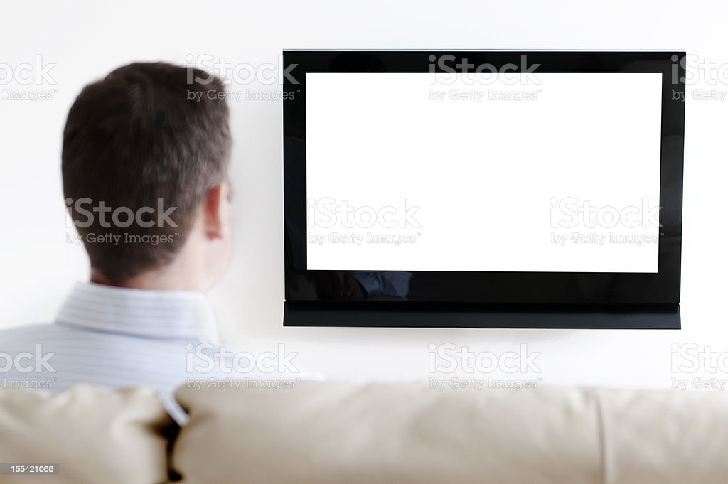Man watches television from a sofa royalty-free stock photo
