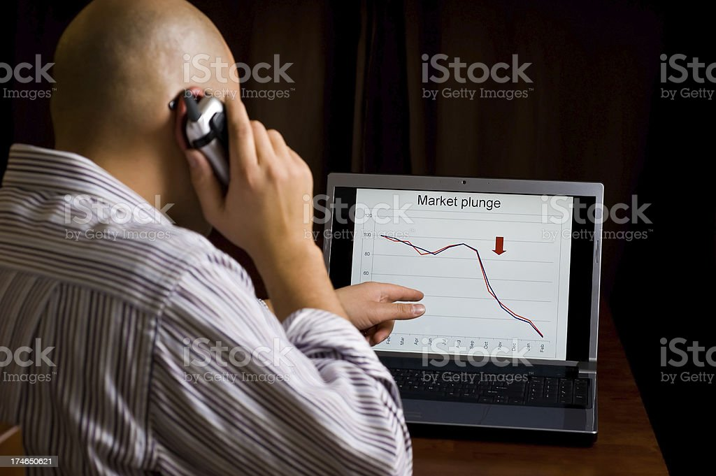 Man watches the market plunge royalty-free stock photo