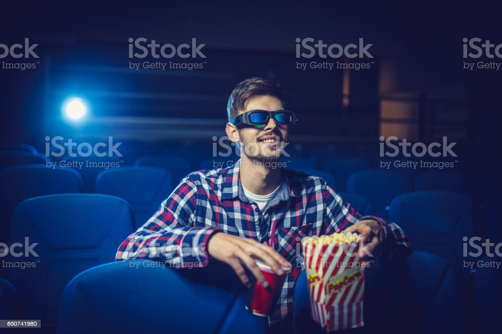 Man watching a comedy movie stock photo