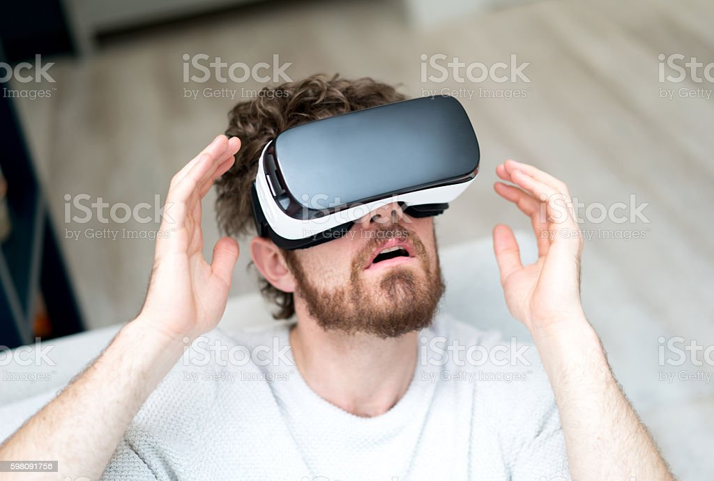 Man watching a movie on a VR device stock photo