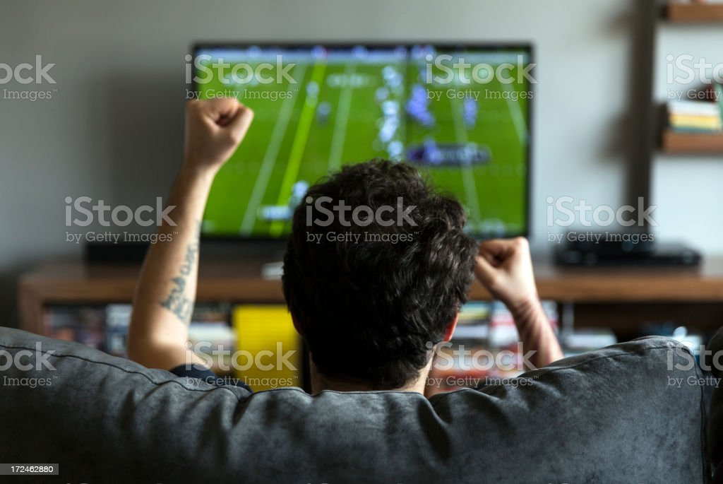 Man watching American football stock photo