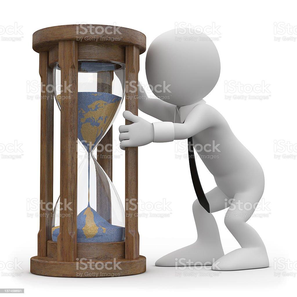 Man watching an hourglass royalty-free stock photo