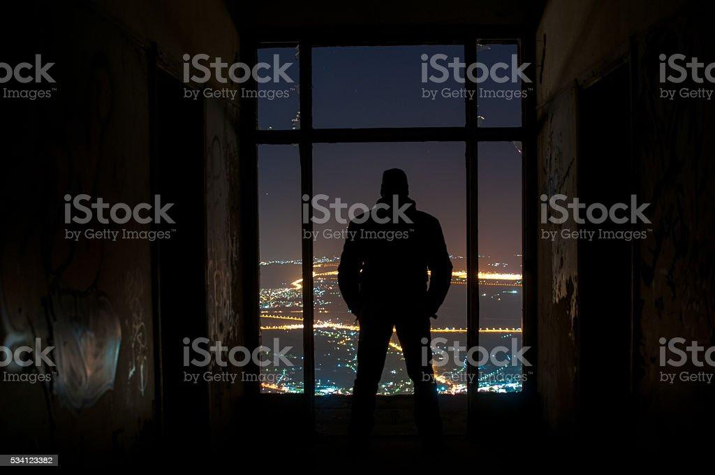 Man watching city view at night stock photo