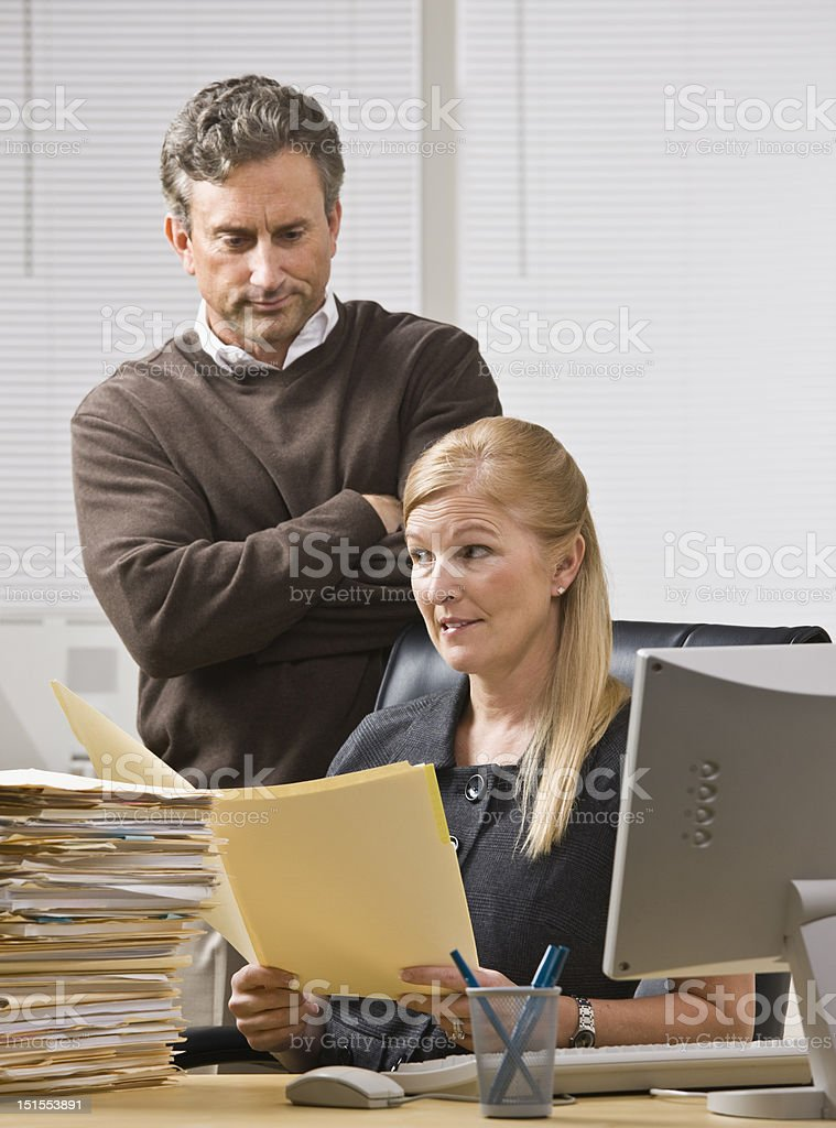Man Watching Co-Worker at Work royalty-free stock photo