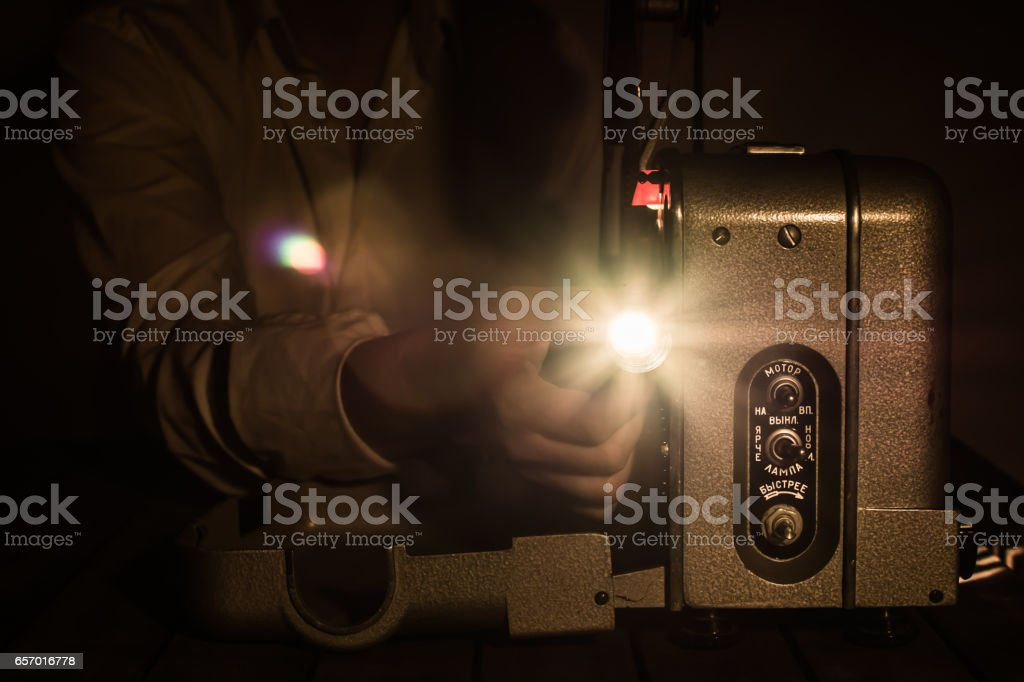 Man watching movie on vintage projector. stock photo
