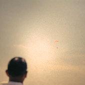 Man Watching Parachuter