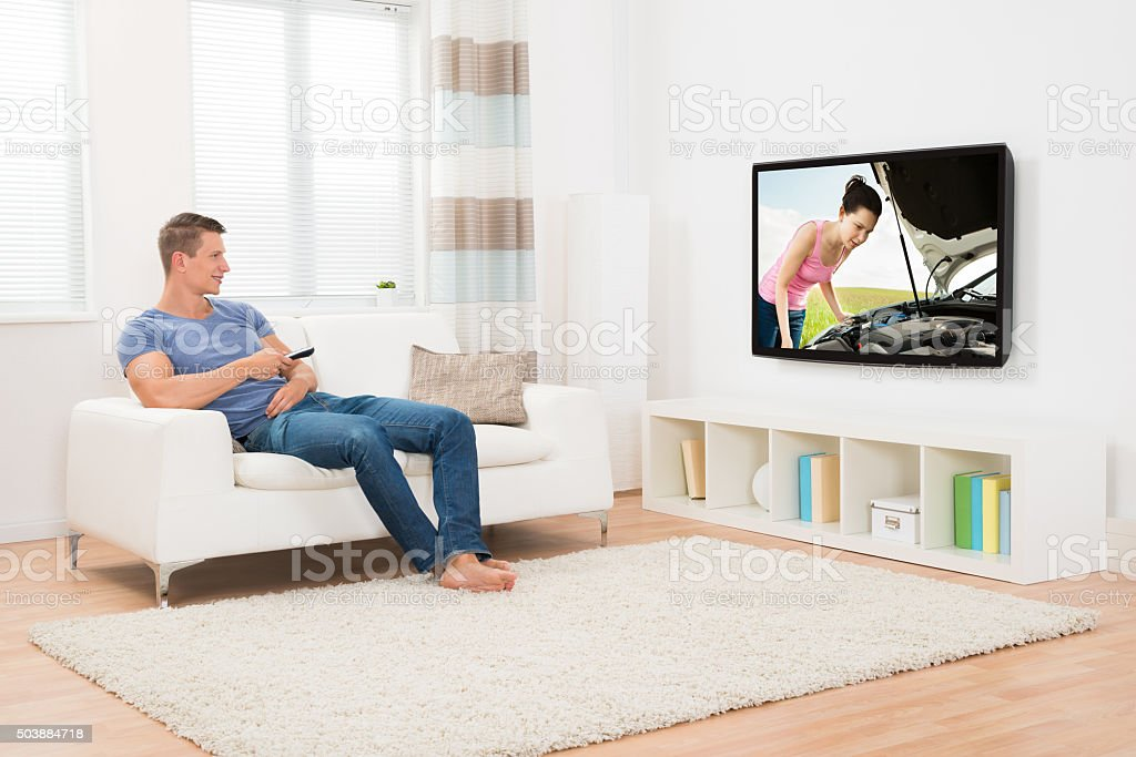 Man Watching Television In Living Room stock photo