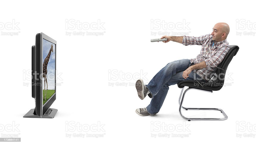 A man watching television with a remote  stock photo
