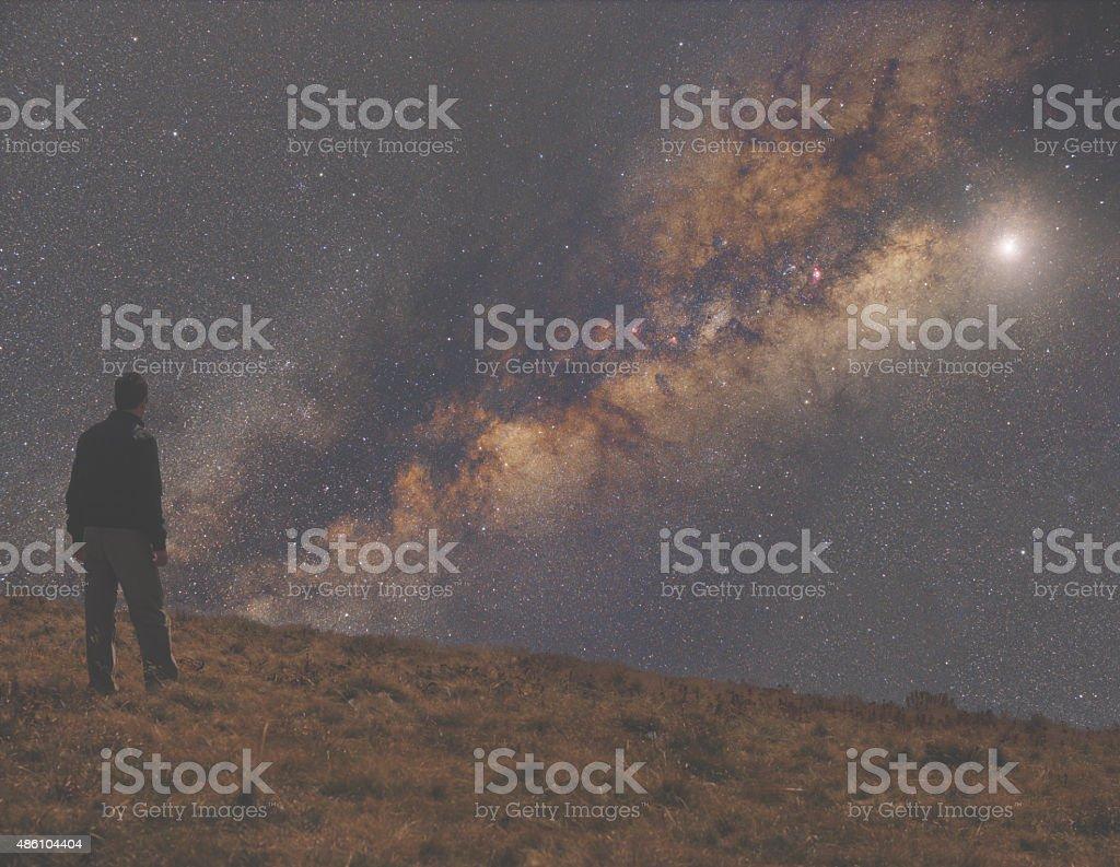 Man watching the stars. stock photo