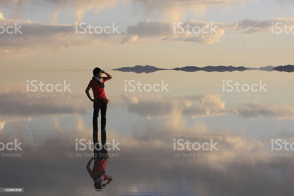 A man watching the sunset at Uyuni salt flat stock photo