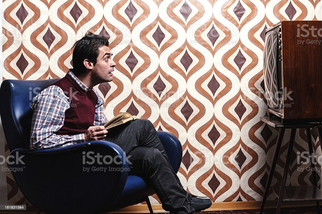 Man Watching the TV in Retro Room with Surprised Expression royalty-free stock photo