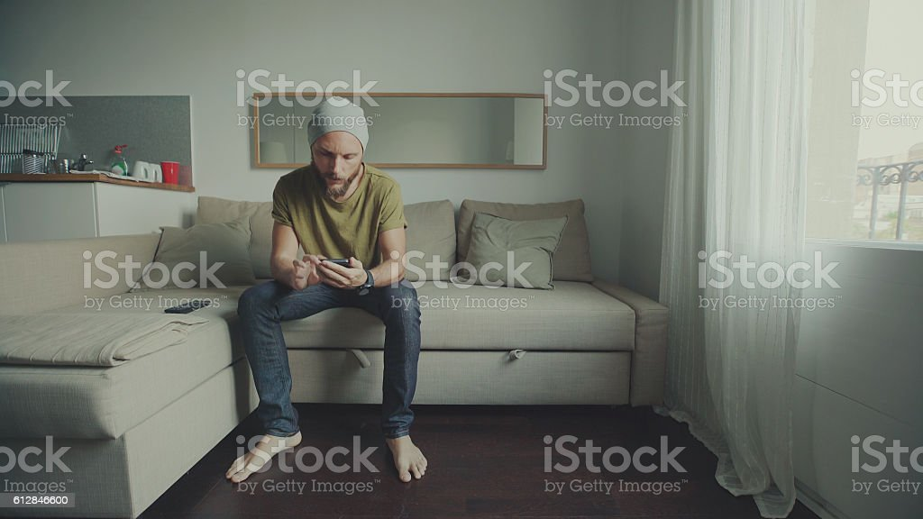 Man watching TV at home stock photo
