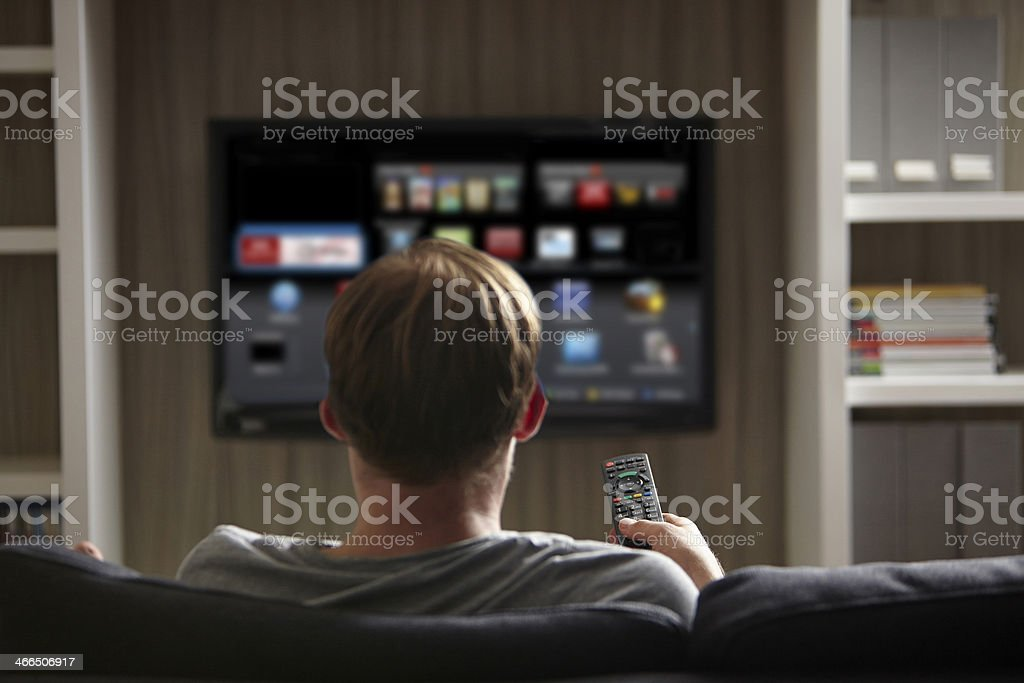 Man watching TV stock photo