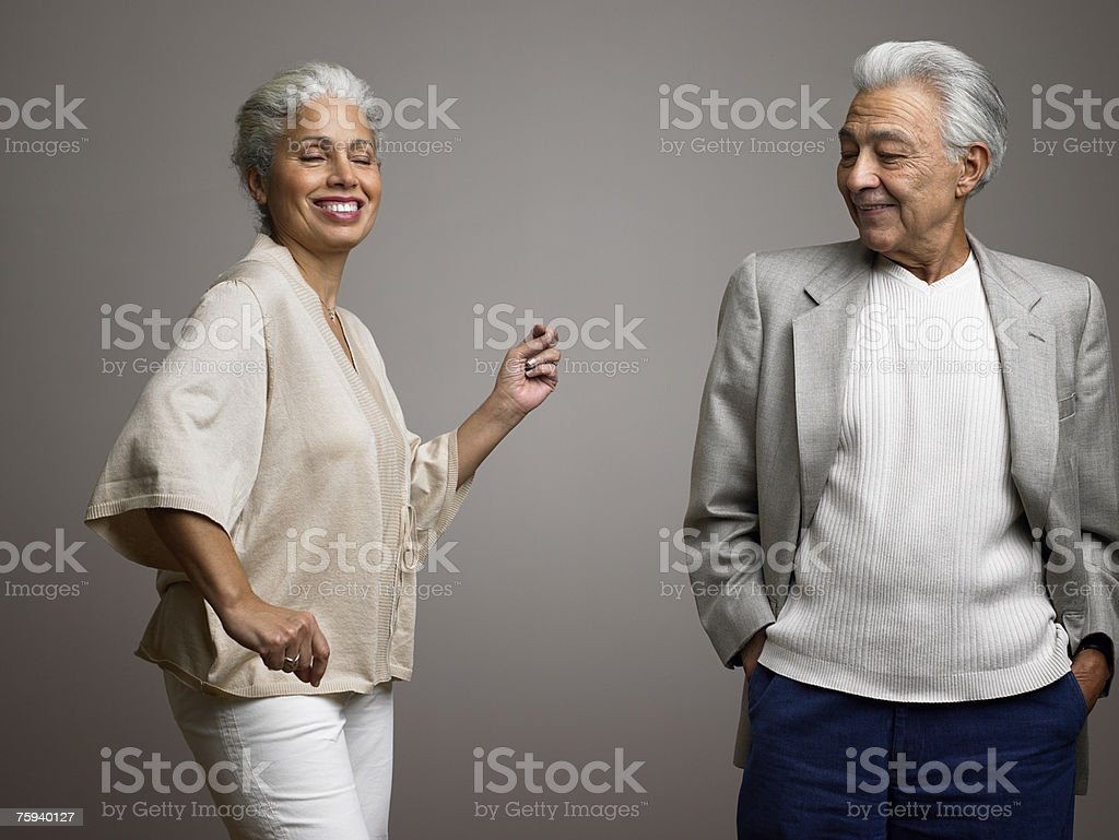 Man watching wife dance stock photo