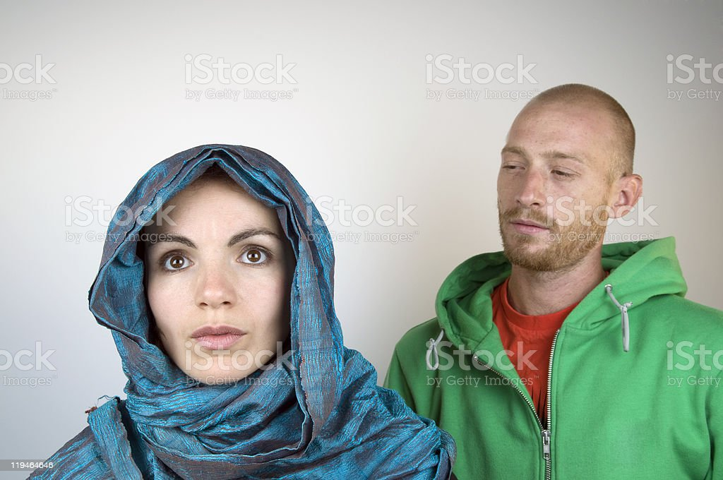 Man Watching Young Woman With Headscarf royalty-free stock photo