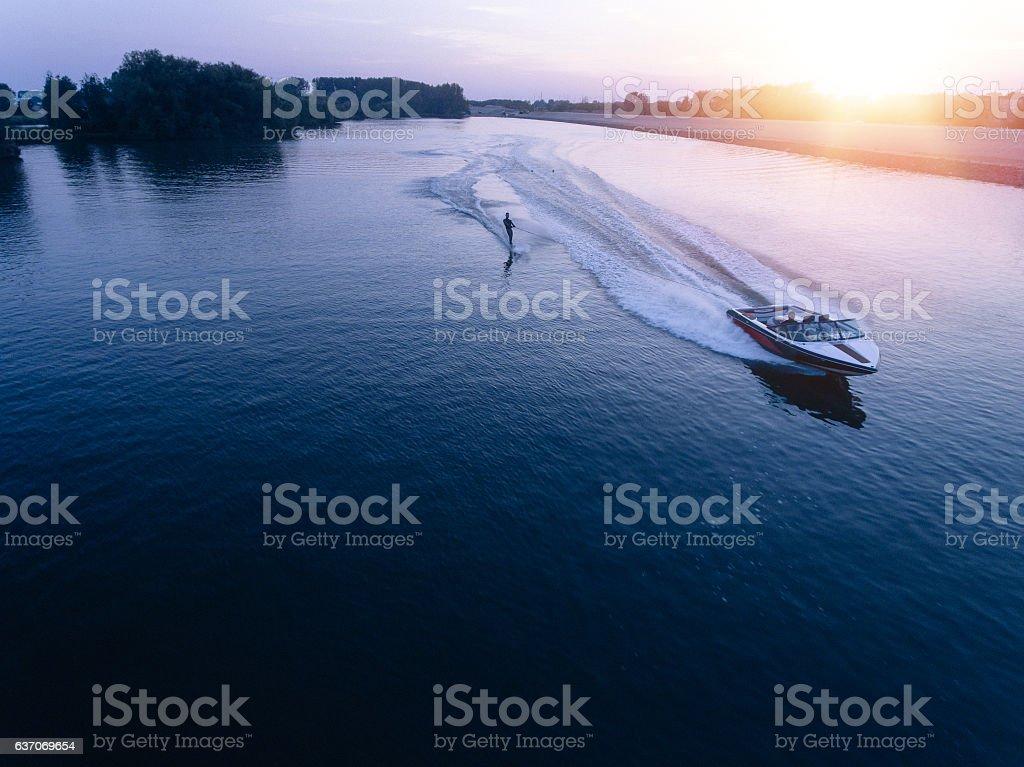 Man water skiiing on lake behind a boat stock photo