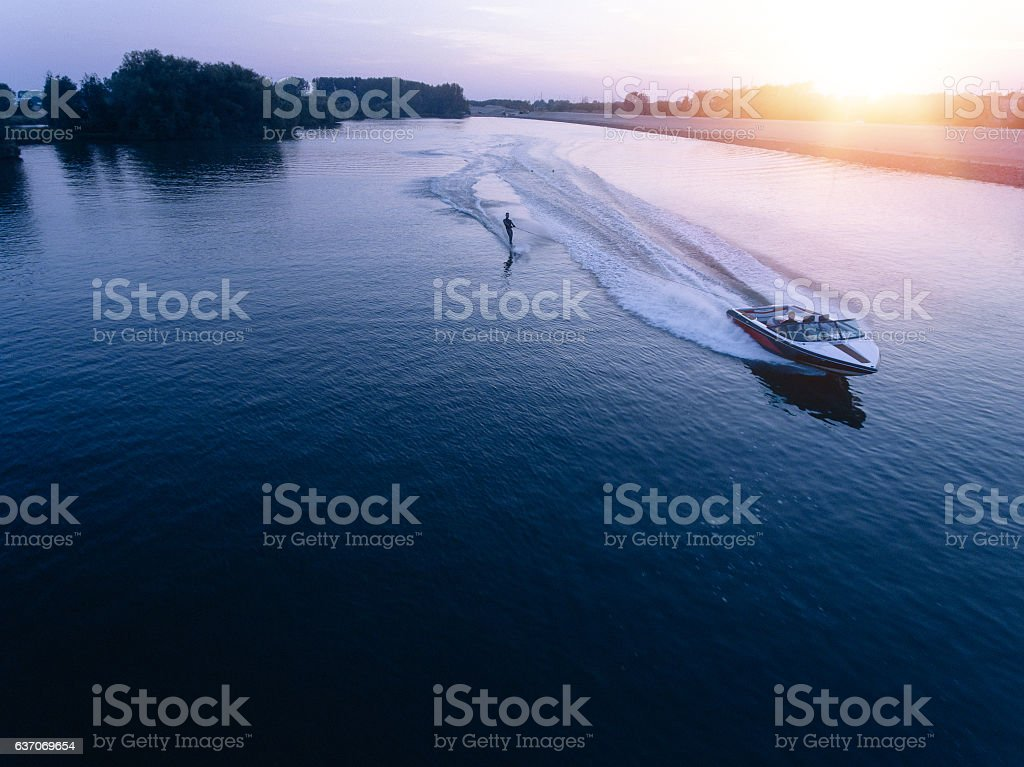 Man water skiiing on lake behind a boat stock photo