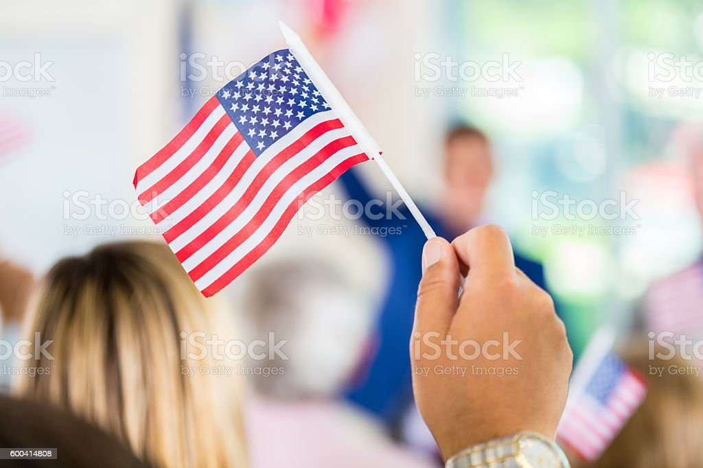 Man waving American flag during political rally for local candidate stock photo
