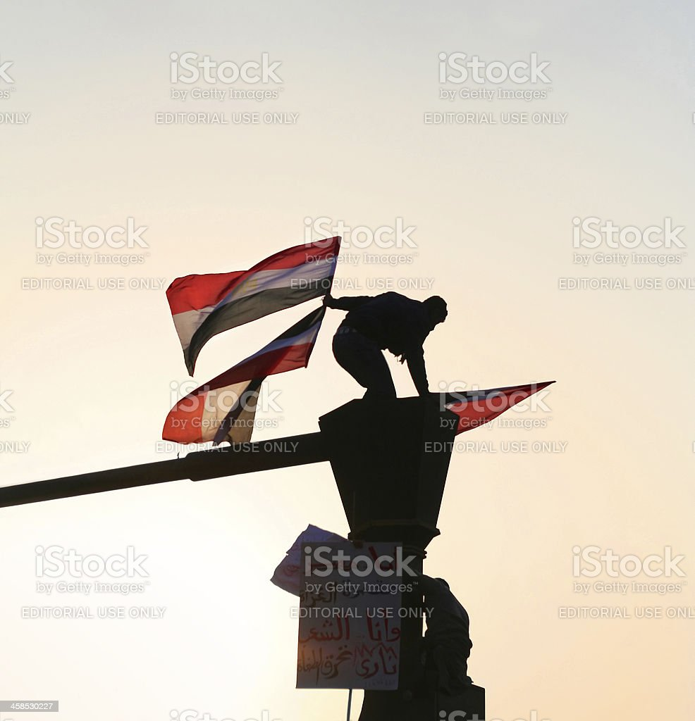 man waving Egyptian flag stock photo