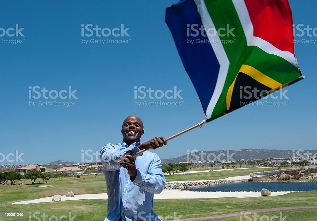 Man Waving South African Flag stock photo