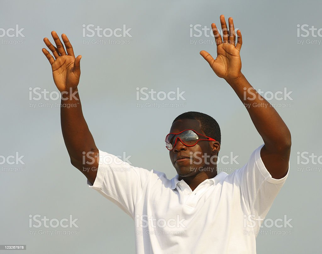 Man Waving to His Friends stock photo