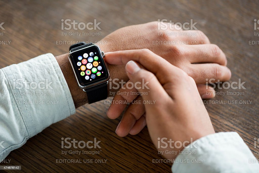 Man wearing 42mm stainless steel Apple Watch stock photo