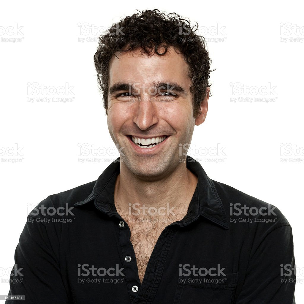 Man wearing a black shirt smiling for a portrait stock photo