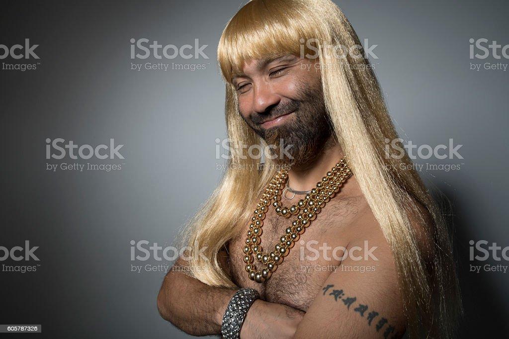 Man wearing a blonde wig. stock photo