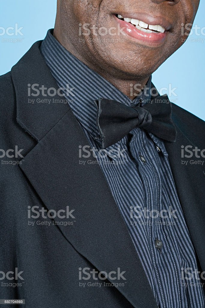 Man wearing a bow tie stock photo