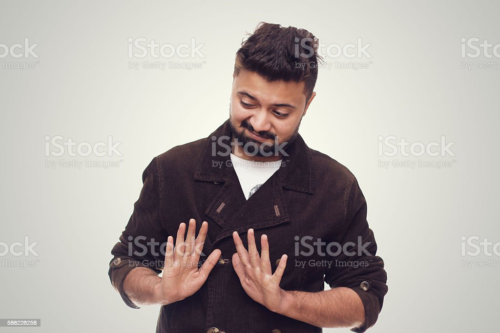 Man Wearing A Brown Coat Refusing Expression stock photo
