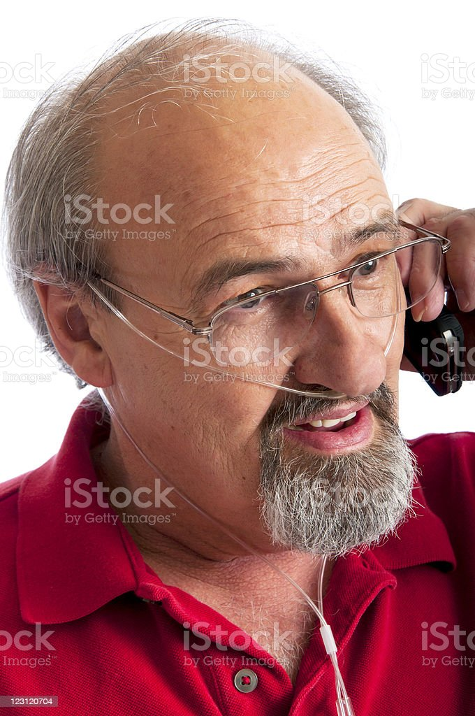Man wearing a cannula for Oxygen talking on the phone stock photo