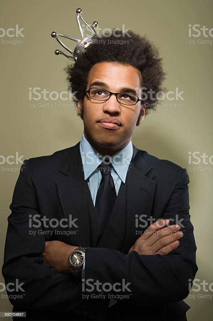 Man wearing a crown stock photo