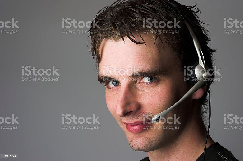 Man wearing a headset stock photo