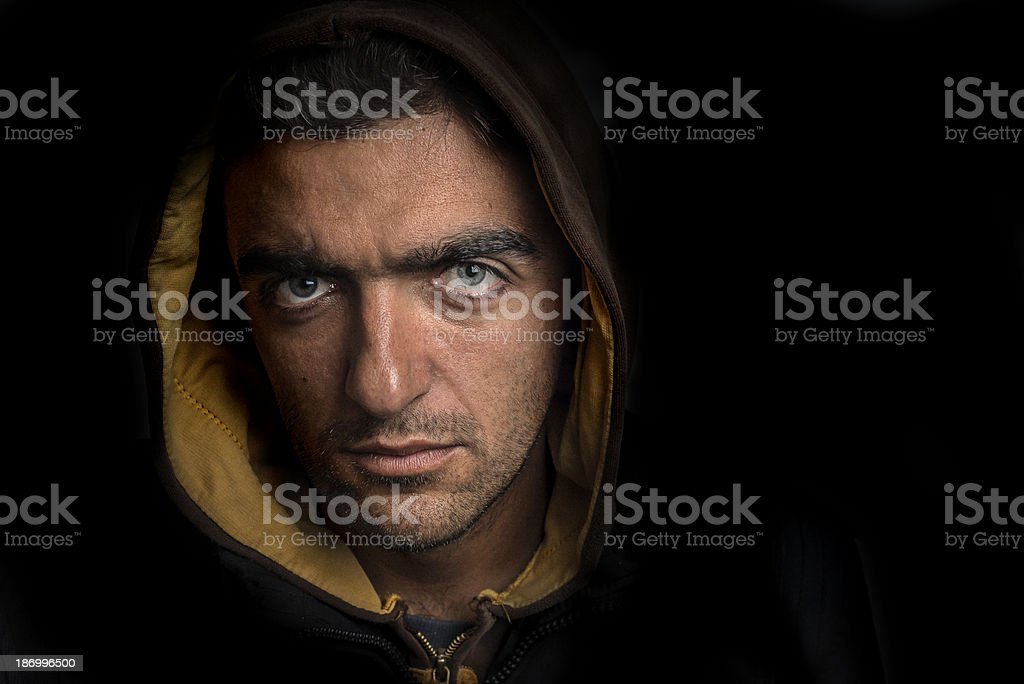 Man wearing a hood in dark royalty-free stock photo