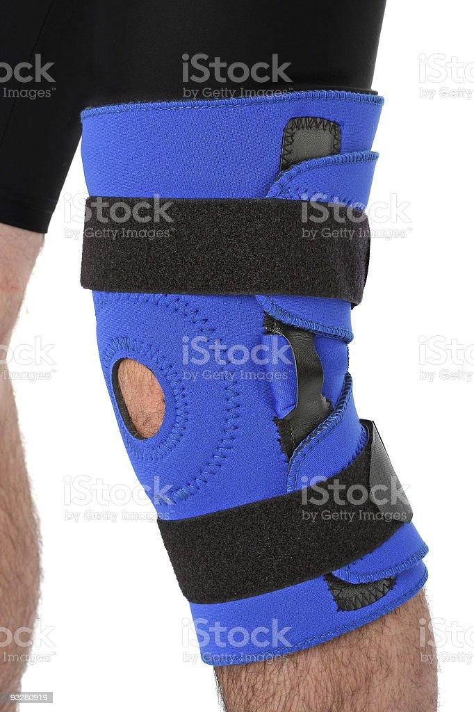 Man wearing a leg brace, over white royalty-free stock photo