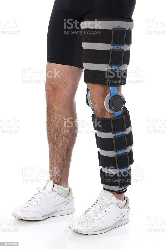 Man wearing a leg brace royalty-free stock photo