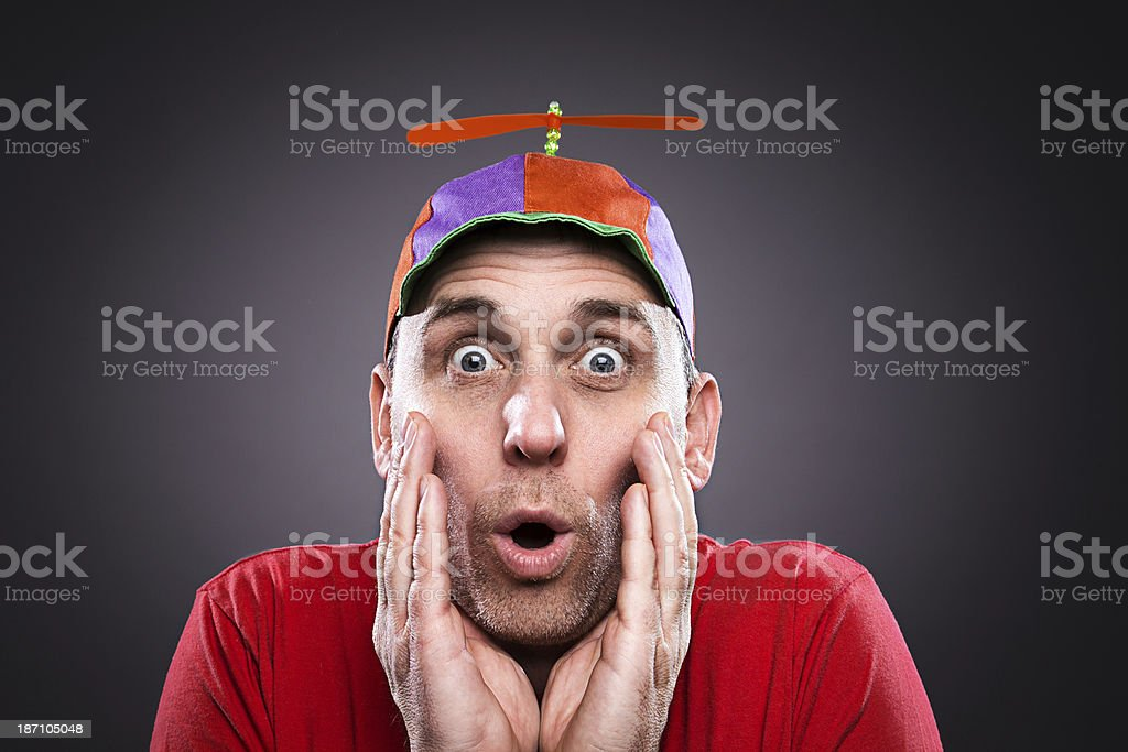 Man wearing a propeller beanie stock photo