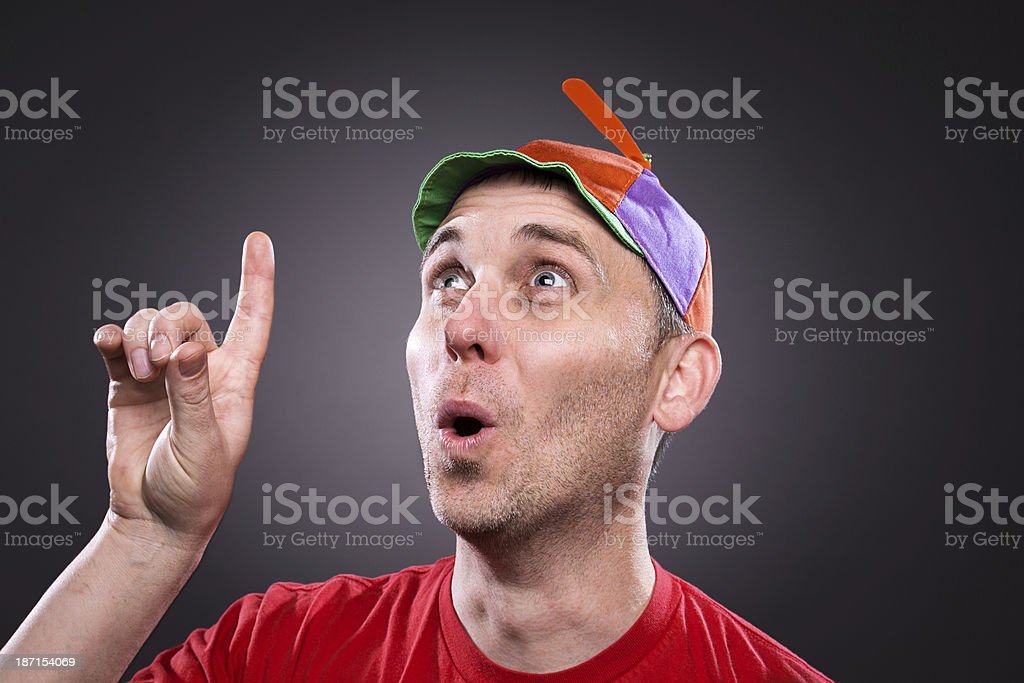 Man wearing a propeller beanie with an idea stock photo