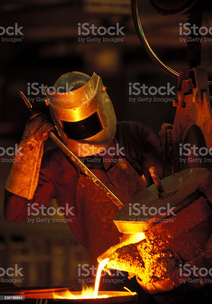 Man wearing a protective mask working in a siderurgy stock photo