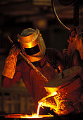 Man wearing a protective mask working in a siderurgy