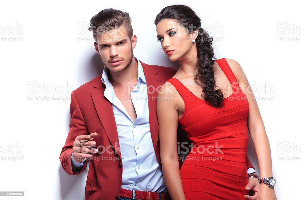 A man wearing a red coat and a woman in a red dress royalty-free stock photo