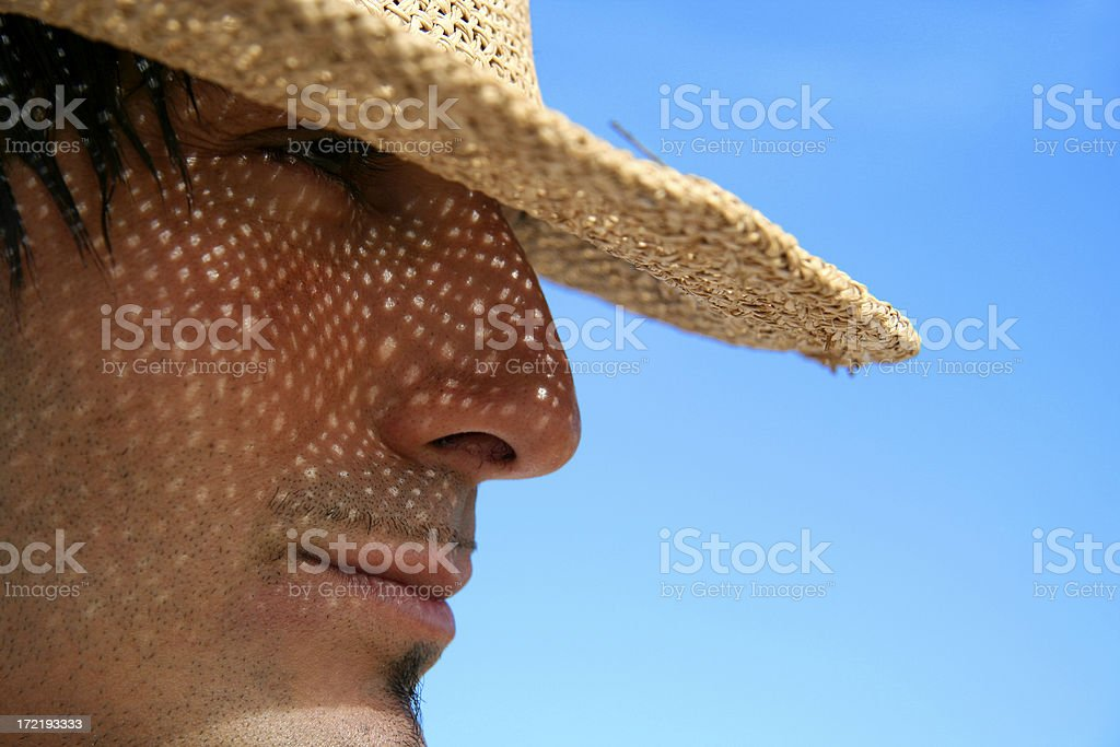 Man Wearing a Straw Hat royalty-free stock photo